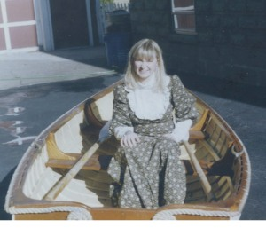 Katherine Kirkpatrick poses in Skippy Lane's rowboat